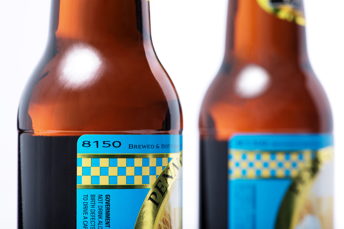 Redimark TC12 thermal inkjet printer mark on coated beer label then applied to bottle. Using T801K ink.