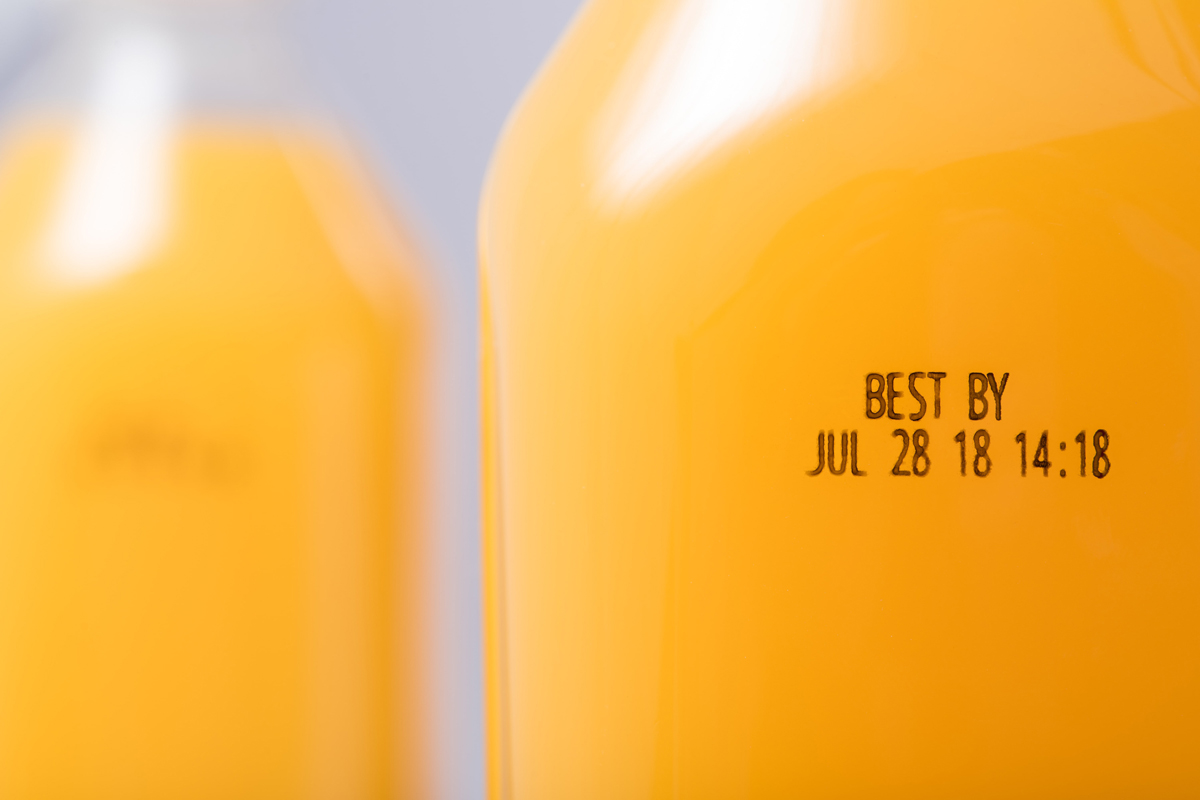Redimark TC12 thermal inkjet printer mark on plastic orange juice bottle. Using T801K ink.